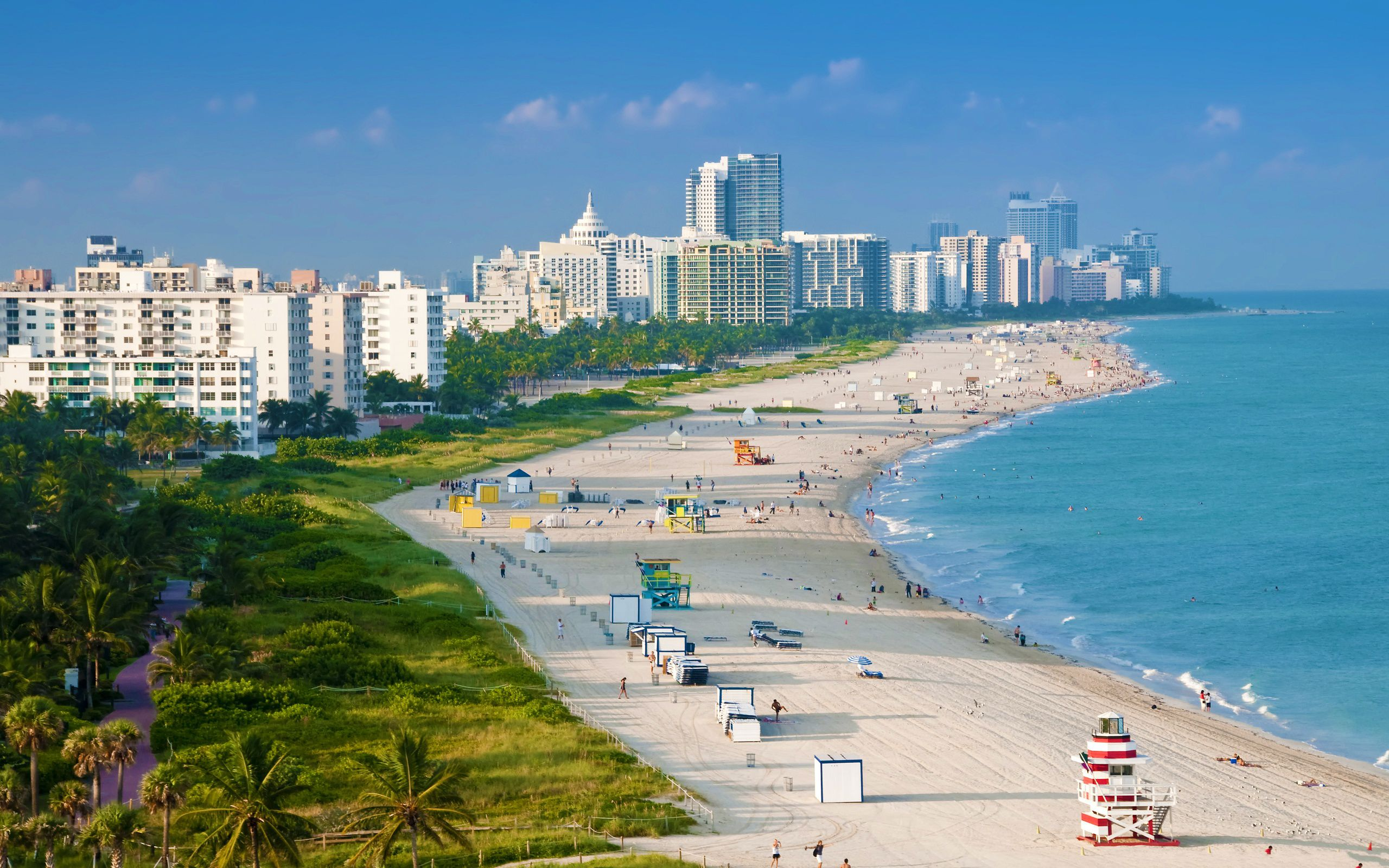 At the shore in Miami Beach, visitors can swim, surf and jet ski in the warm and crystal-clear Atlantic waters. You can also nap on the white sands, work on a tan or simply watch the beautiful people, especially at South Beach, a favorite of models and celebrities.